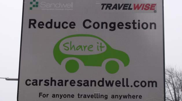 Reduce congestion road sign