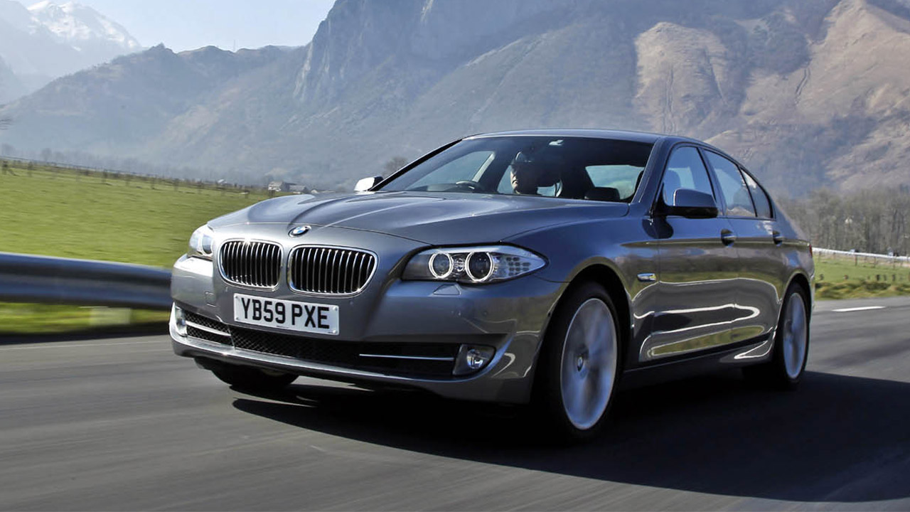 BMW 5 Series driving, front quarter