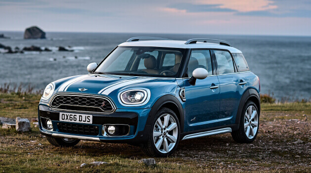 Blue Mini Countryman near cliff