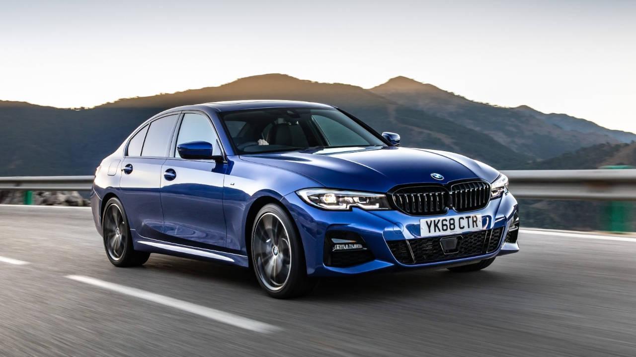 Blue BMW 3 Series, driving