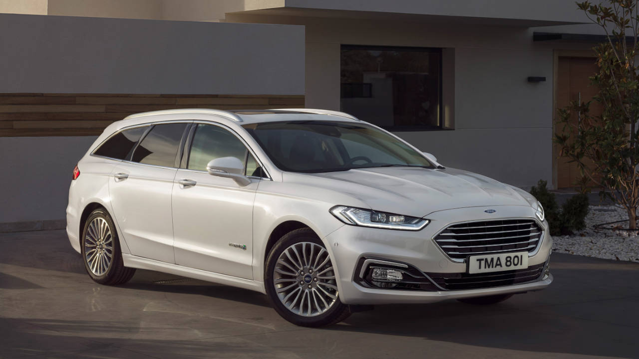White Ford Mondeo Estate, parked
