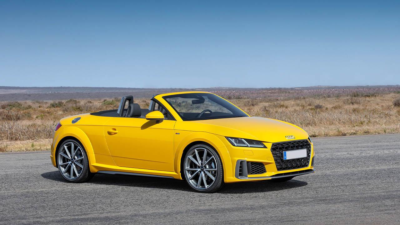 yellow audi tt roadster, parked