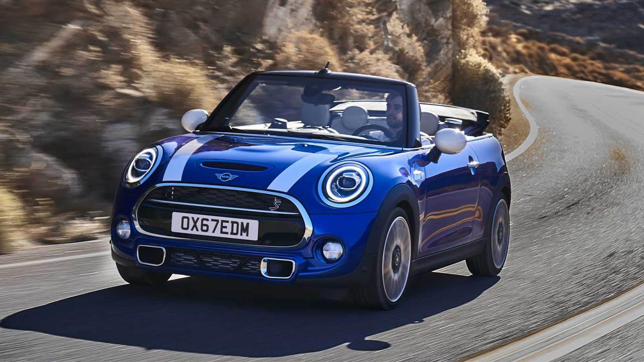 blue mini convertible, driving