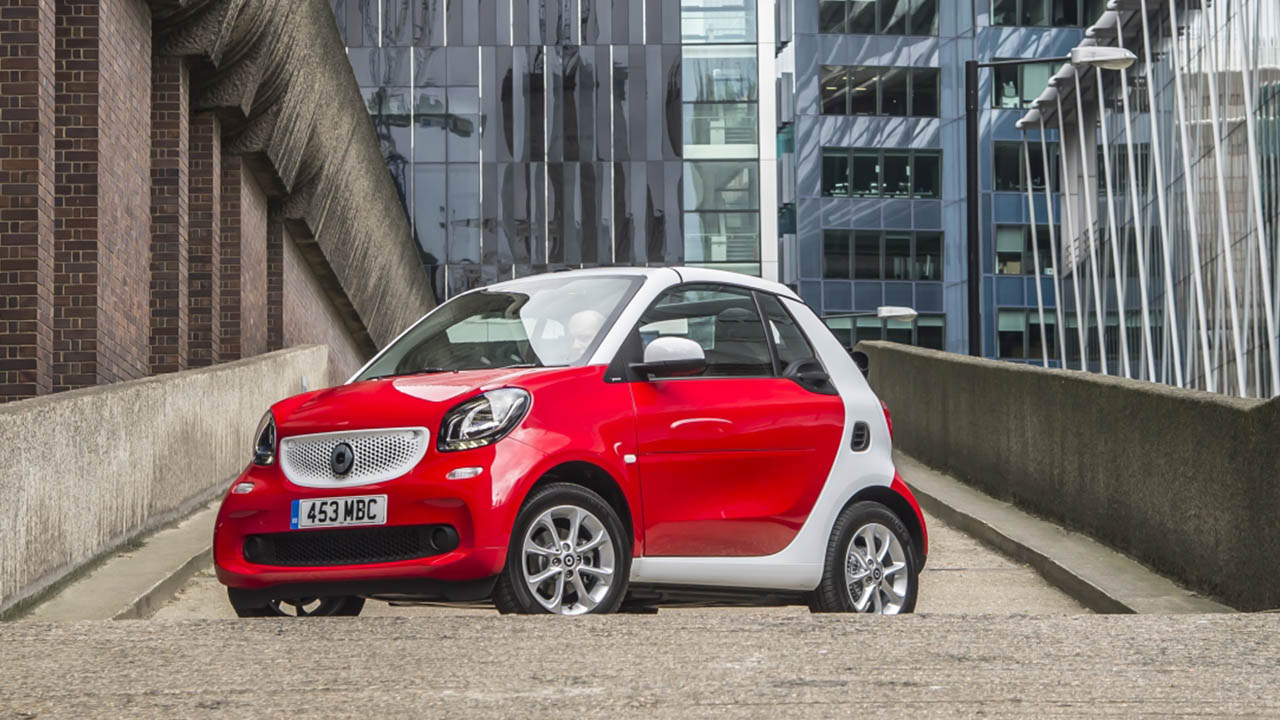 red smart fortwo cabrio, parked