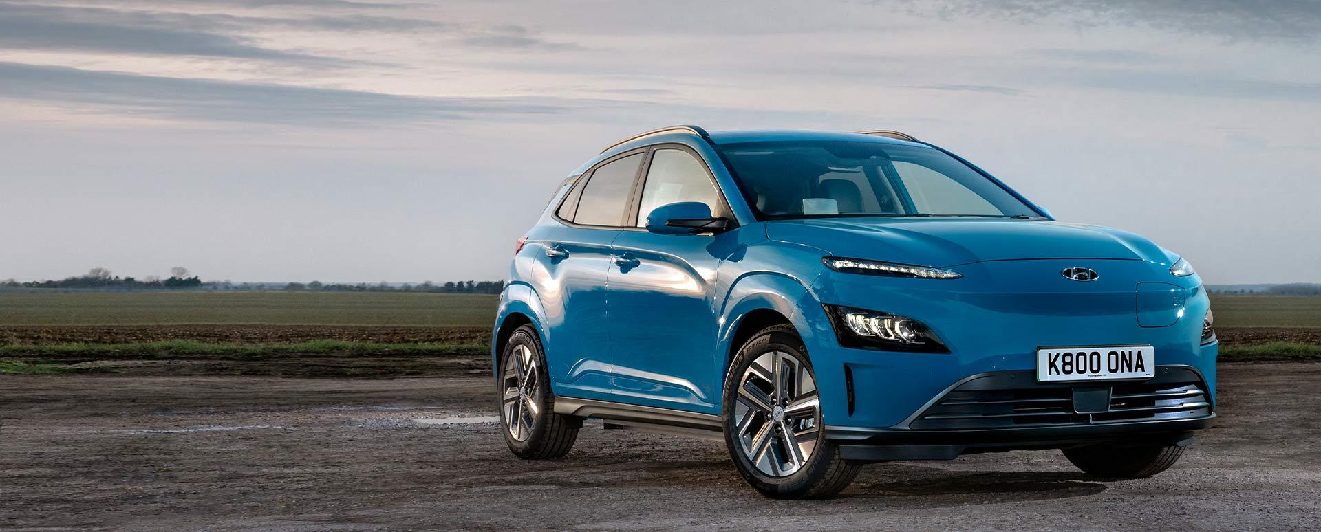 blue hyundai kona electric, parked