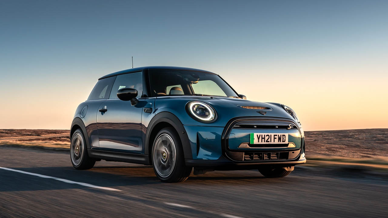 mini electric, driving in sunset