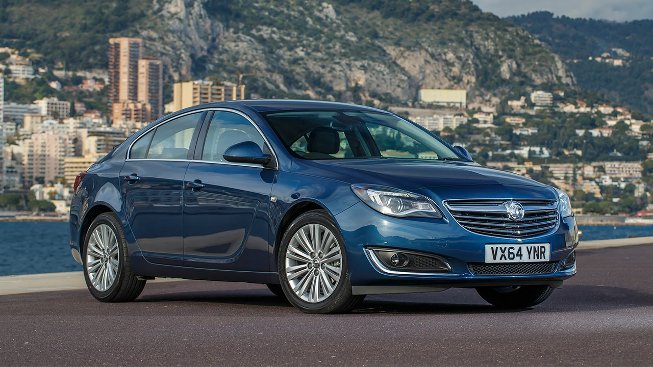 Blue Vauxhall Insignia, parked