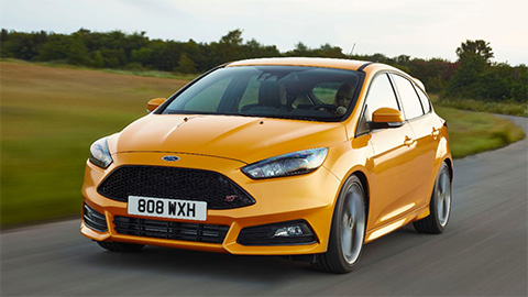 orange ford focus st driving