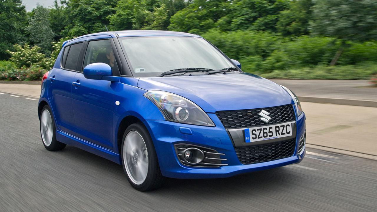 blue suzuki swift sport driving