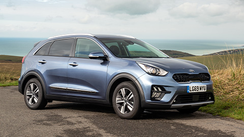 Kia Niro, parked in the countryside