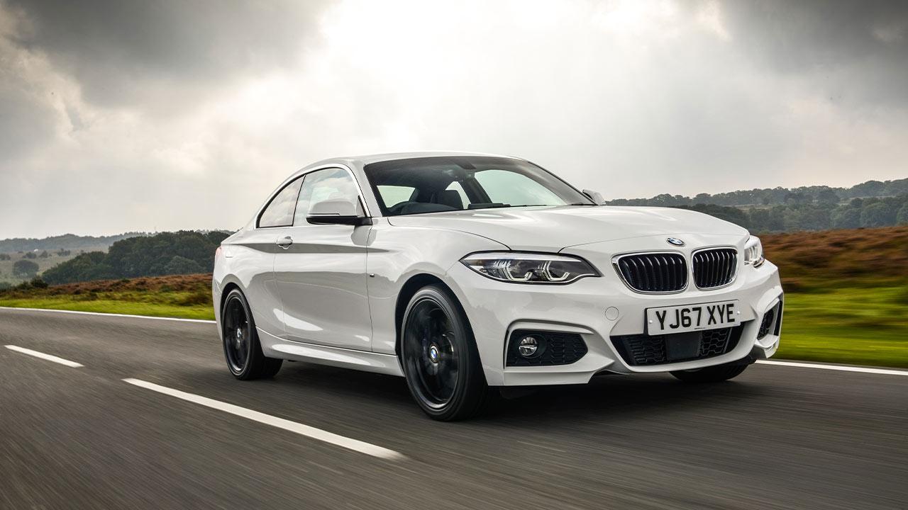 White BMW 2 Series, driving