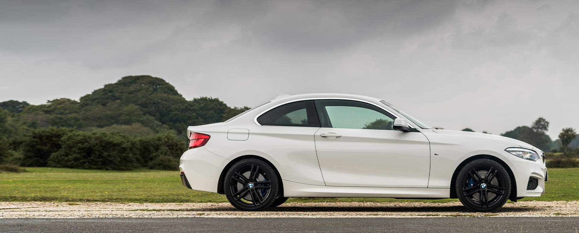White BMW 2 Series, side profile