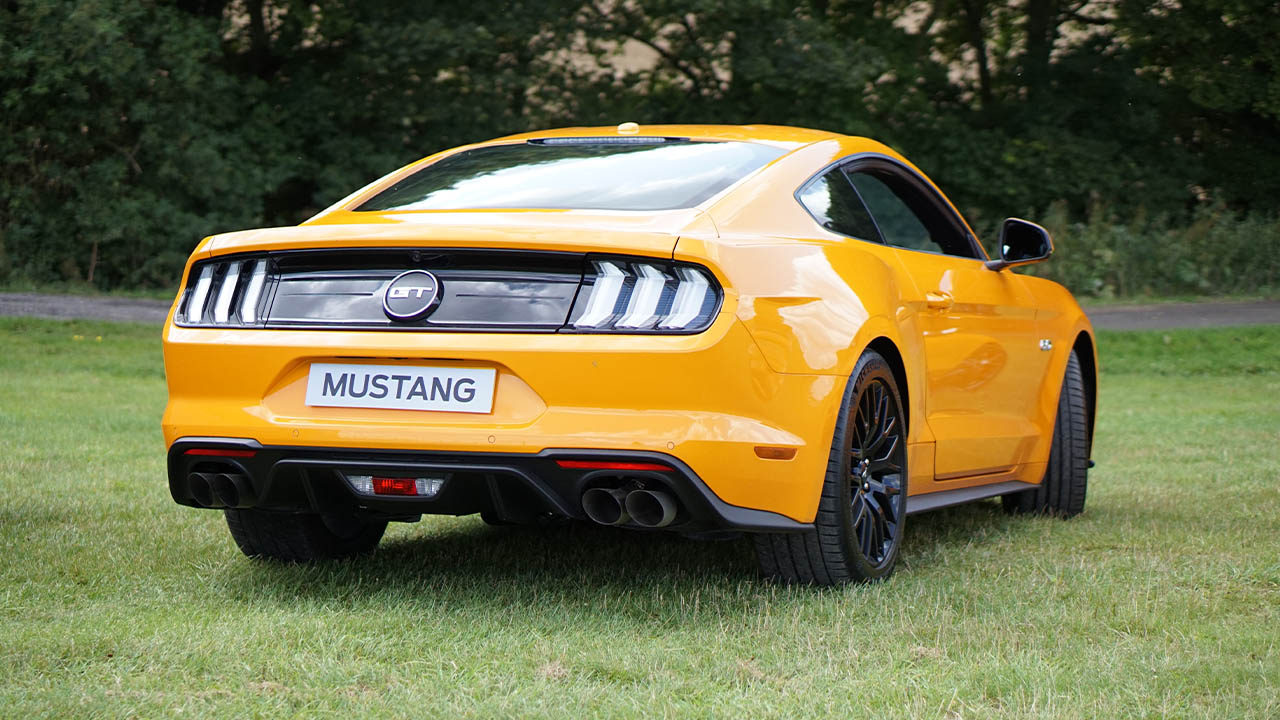 Yellow Ford Mustang, parked