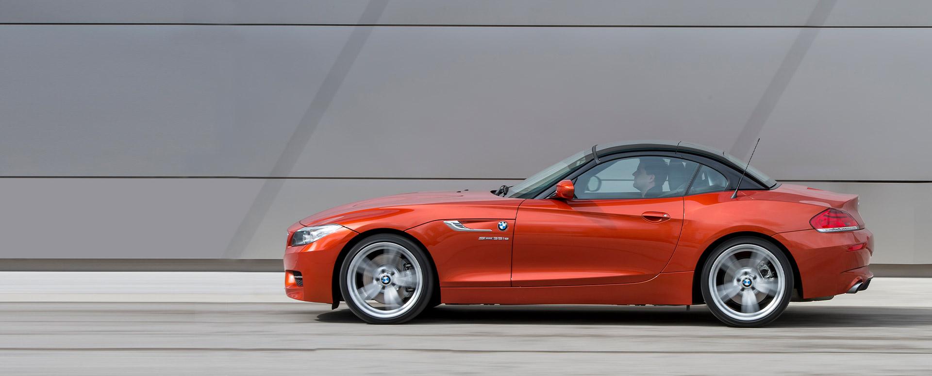 Orange BMW Z4, side profile
