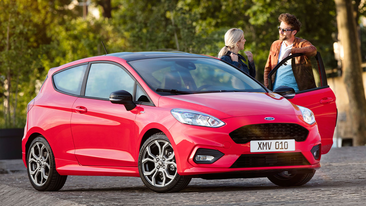 Red Ford Fiesta, parked