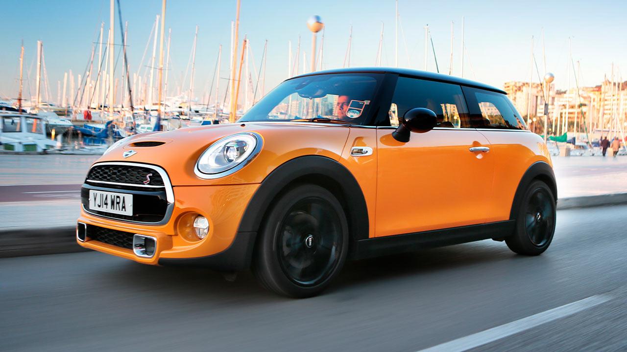 Orange MINI Cooper S, driving