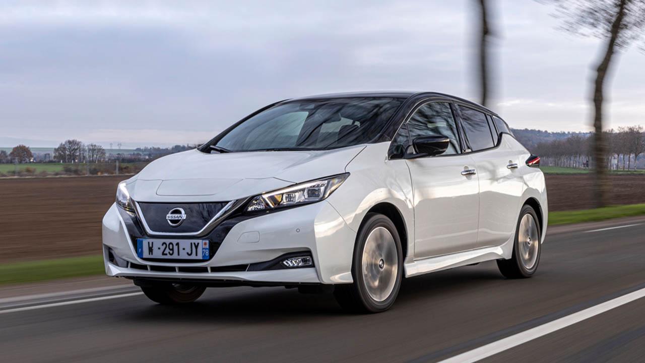 White Nissan LEAF, driving