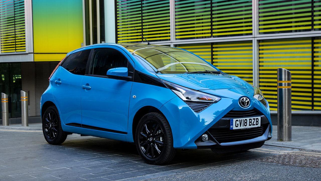 Light Blue Toyota AYGO, parked