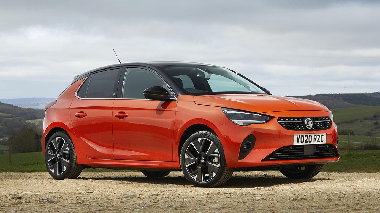 Orange Vauxhall Corsa E, parked