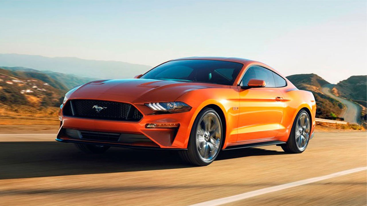 orange ford mustang, front quarter, driving