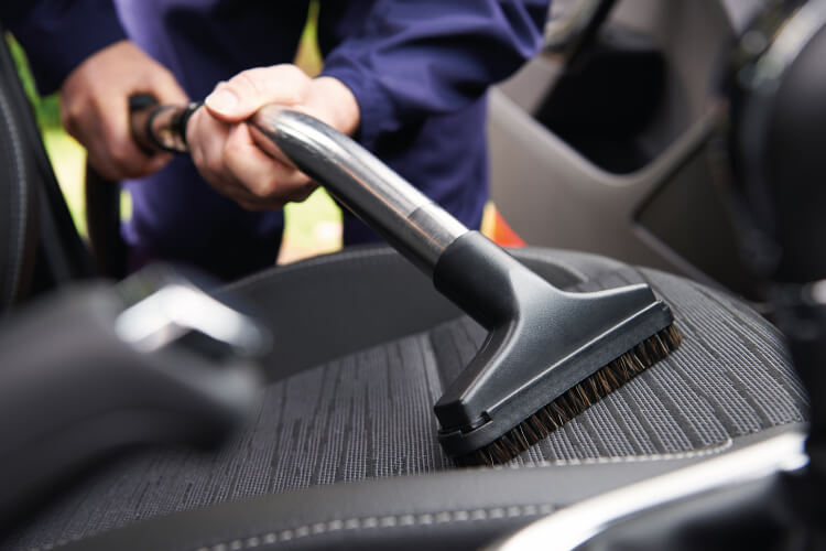 Vacuuming car interior