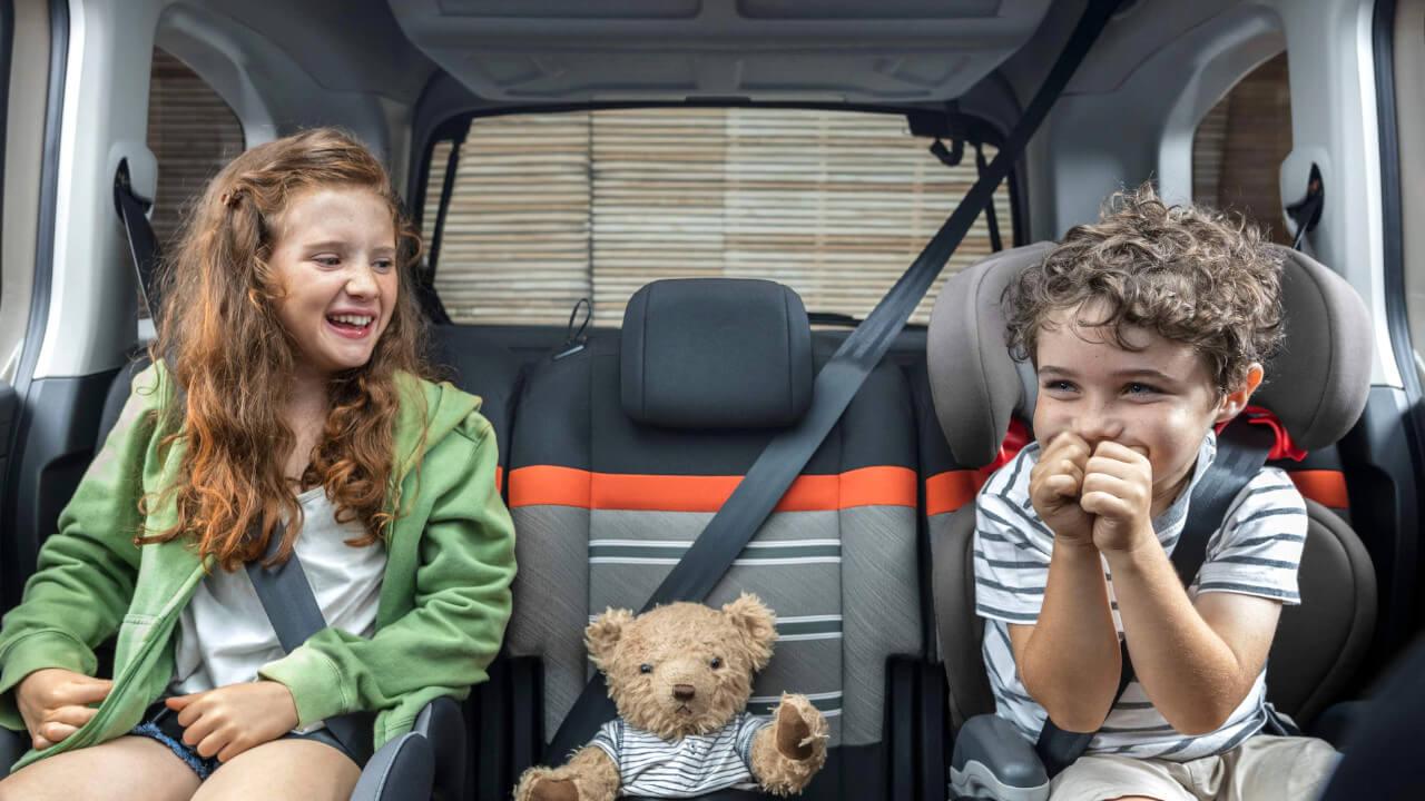 Children sat in Citroen Berlingo with a teddy bear
