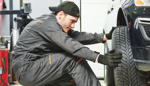 Mechanic changing a tyre
