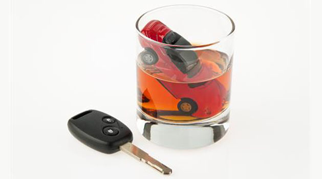car key next to a drink