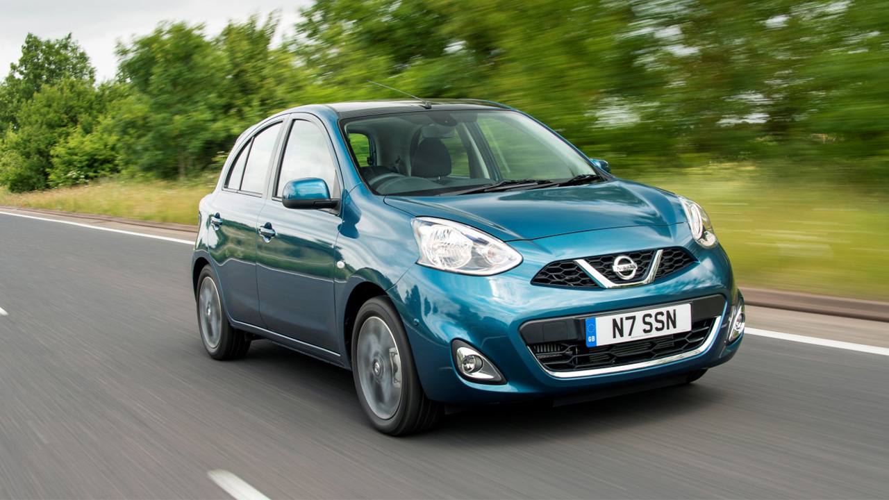 Blue Nissan Micra, driving
