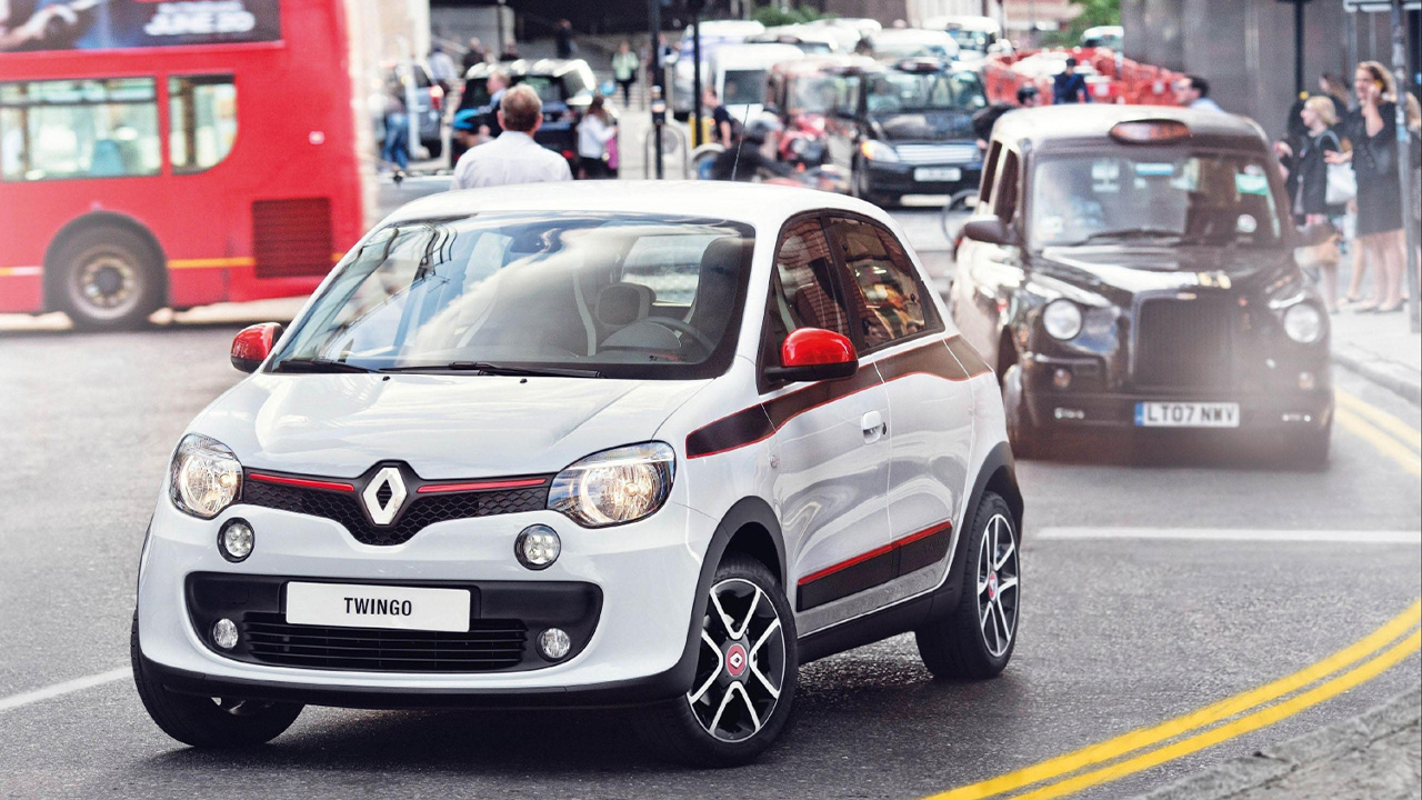 White Renault Twingo, driving in the city