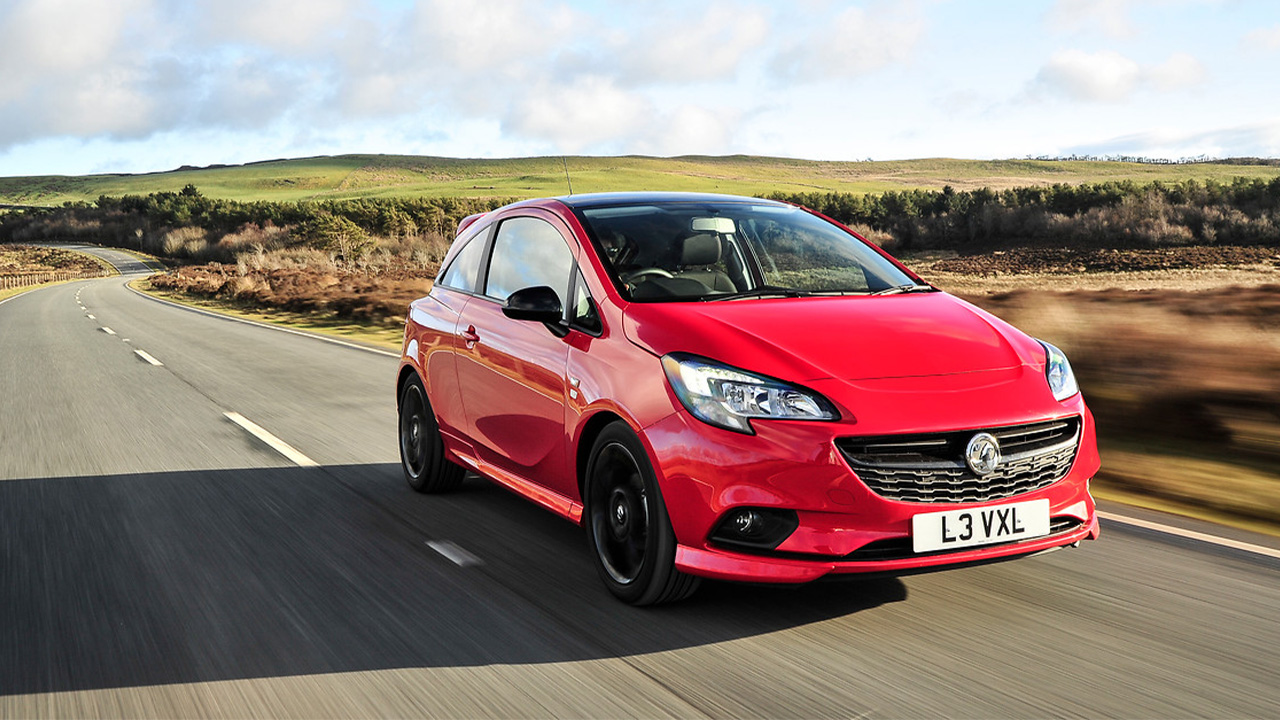 Red Vauxhall Corsa, driving