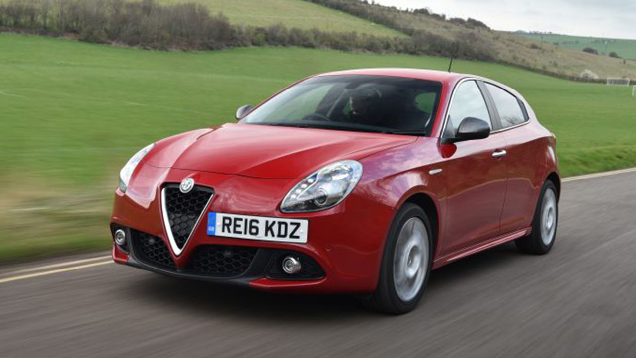 Red Alfa Romeo Guilietta, driving