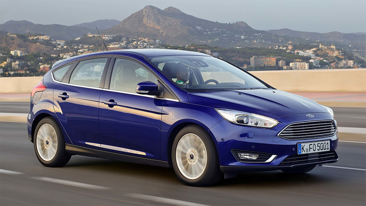 Blue Ford Focus, driving