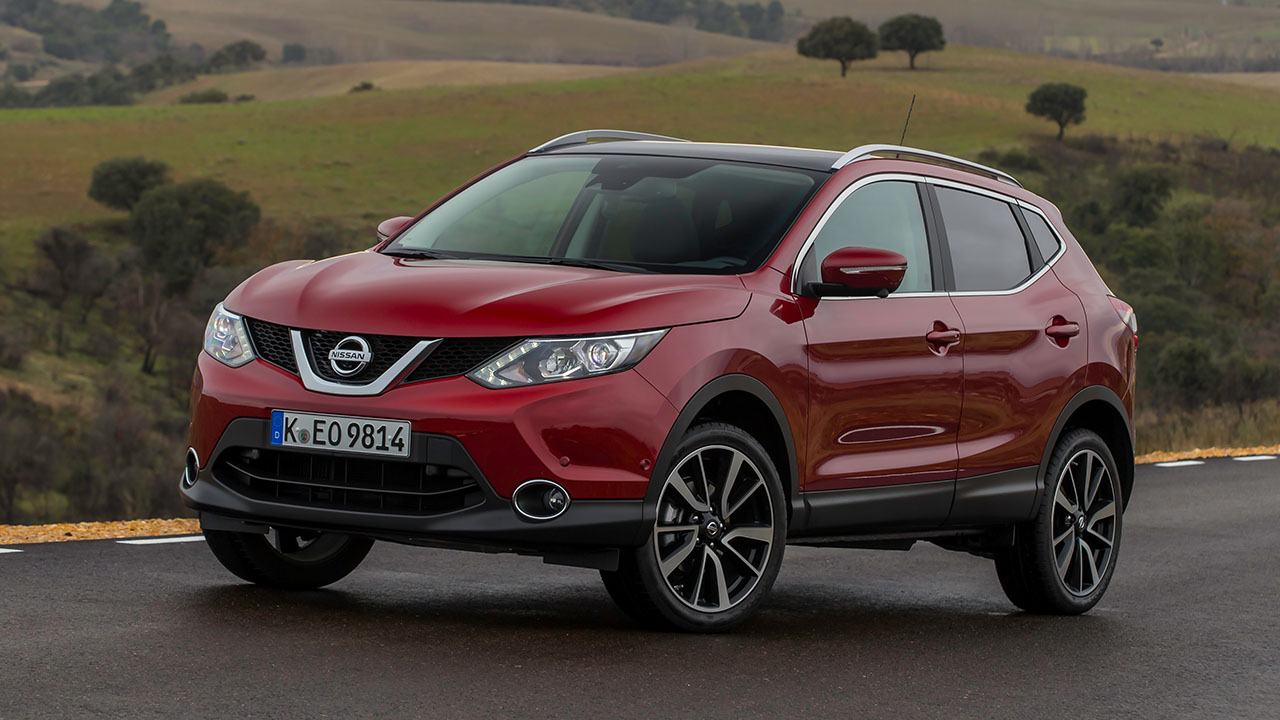 Red Nissan Qashqai, parked in countryside