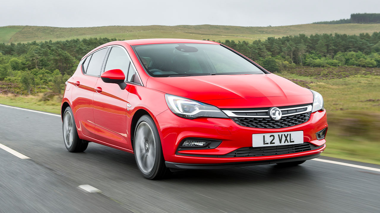 Red Vauxhall Astra, driving in countryside