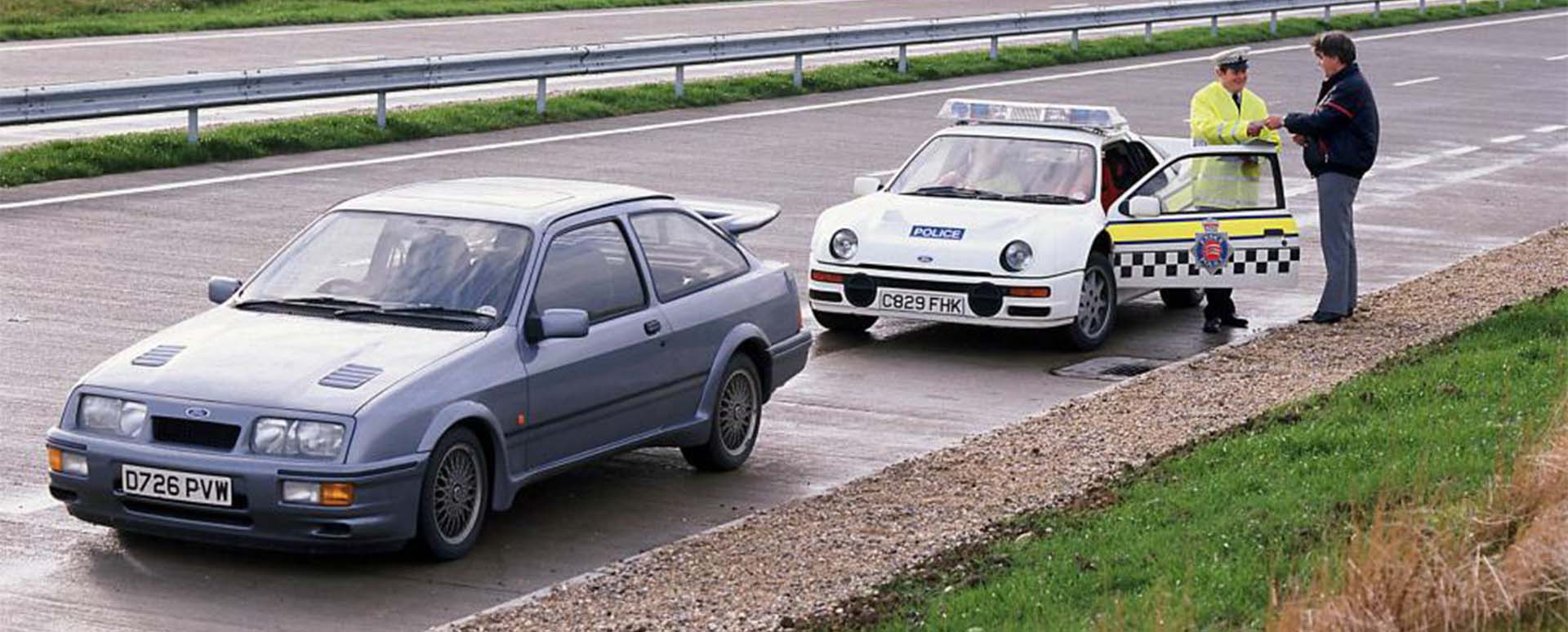 Ford RS200 police car pulling over Ford Sierra Cosworth