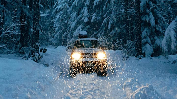 Car Driving in the Snow in the Dark