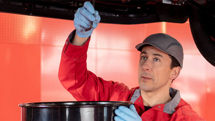 technician carrying out an oil change