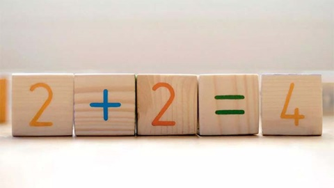wooden blocks with simple maths sum