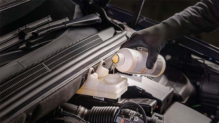 technician topping up ds engine fluids