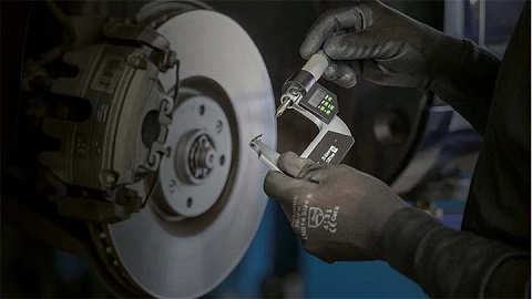 brake disc thickness being measured