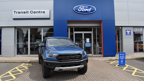 Ford Transit Centre with Ford Raptor Outside