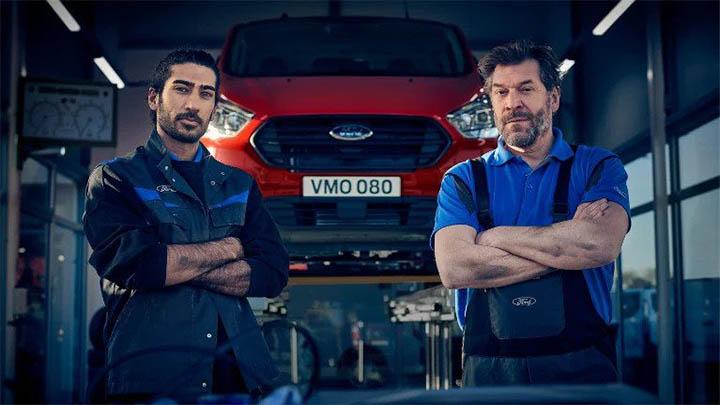 ford technicians standing in front of van