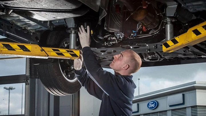 Ford Technician performing repair