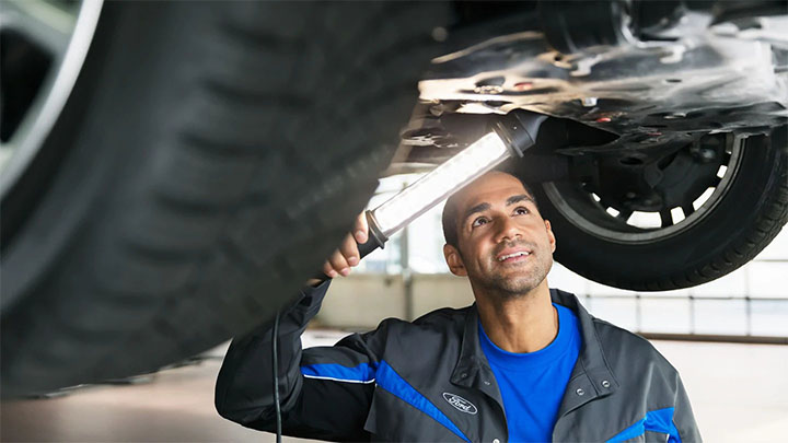 Ford technician performing a vehicle health check