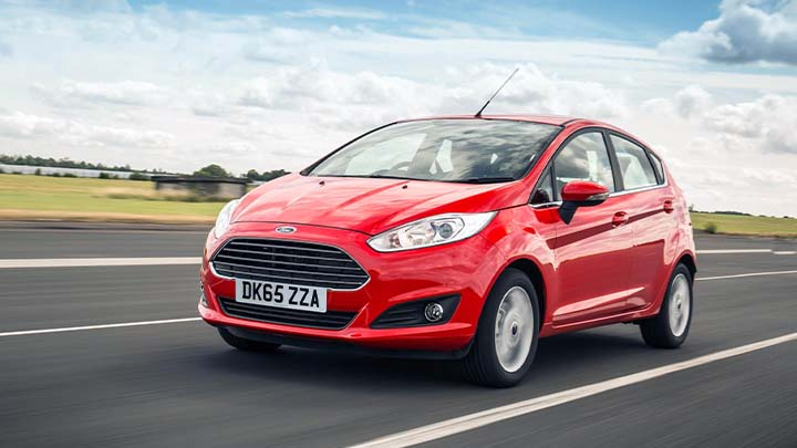 red ford fiesta driving