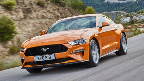 orange ford mustang, driving