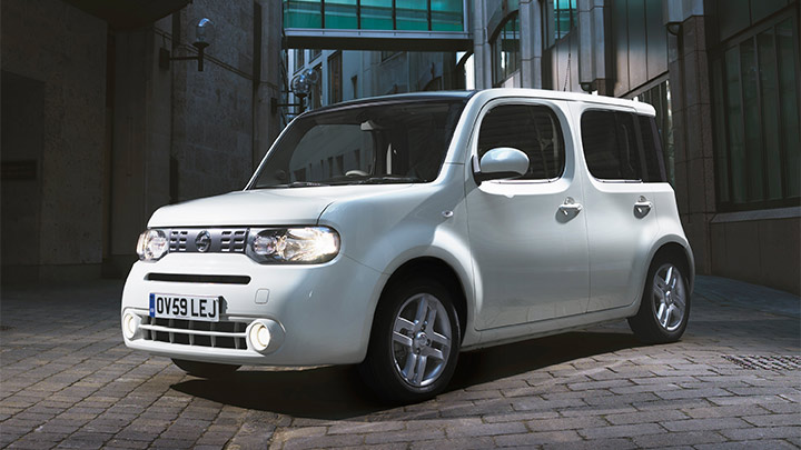 white nissan cube parked