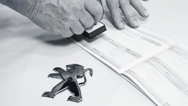 peugeot service book being stamped
