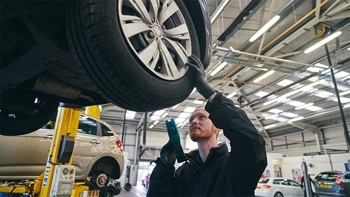 technician inspecting health of vehicle tyre